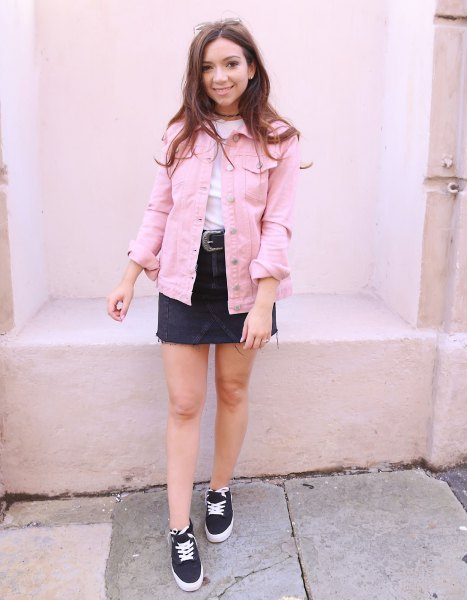 light pink denim jacket with white tee and black denim skirt