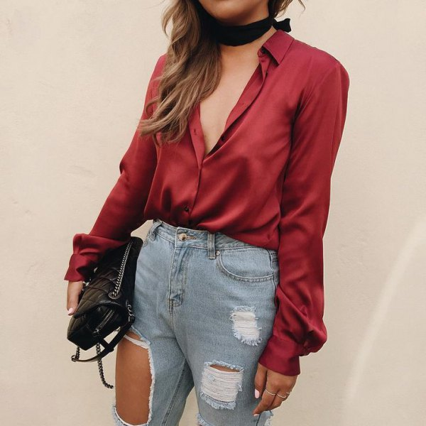 red satin shirt with black choker and ripped jeans