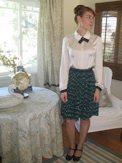 light yellow band shirt with midi black puffy skirt