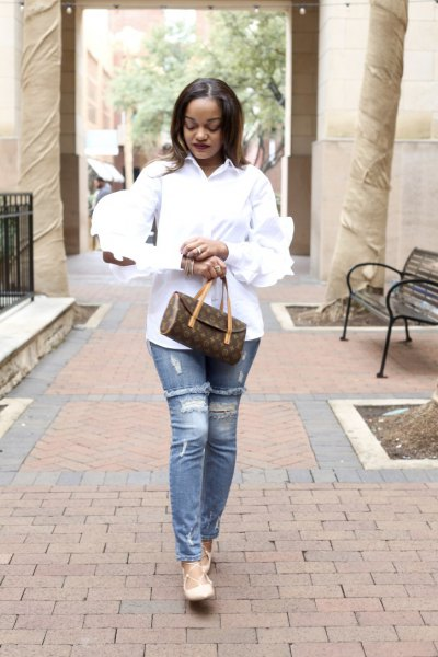 white ruffle sleeve button up shirt with ripped slim cut jeans