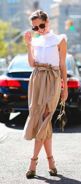 white mock neck sleeveless, ruffled shoulder sweater with blush waist midi skirt