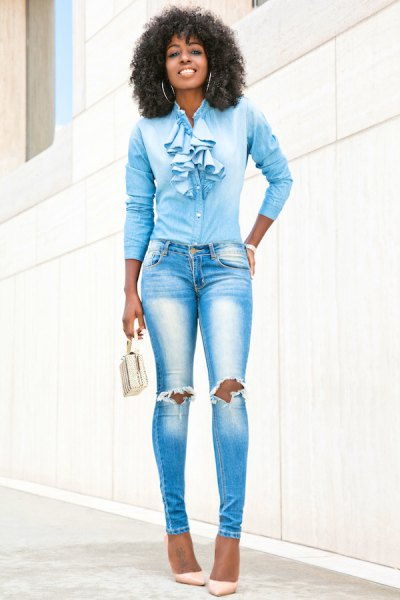 blue shirt with ruffled bow and cut with ripped skinny jeans