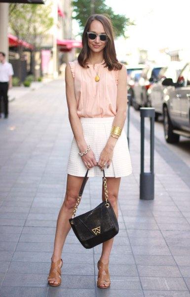 light yellow sleeveless shirt with white floating mini shorts