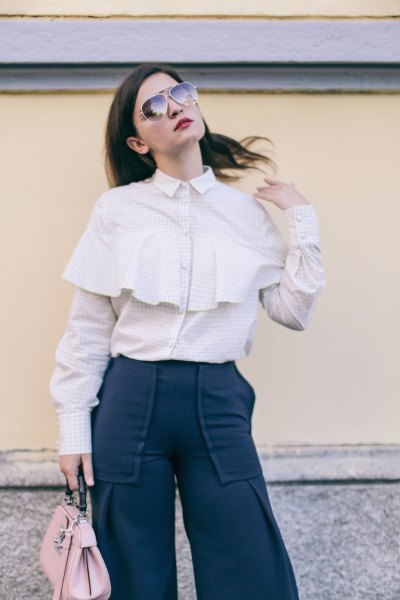 light pink ruffle-up shirt with black high-rise pants