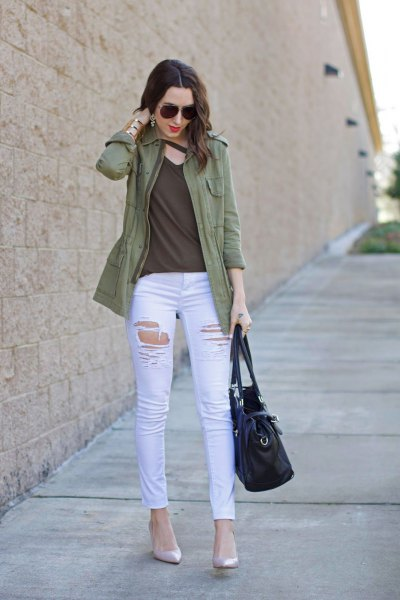 casual olive jacket with green top on the v-neck and white skinny jeans