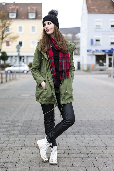 green long jacket with red and black checkered scarf