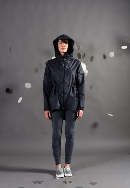 black nylon jacket with gray running tights