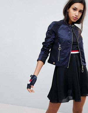 Black cotton nylon jacket with crop top and mini skater chiffon skirt