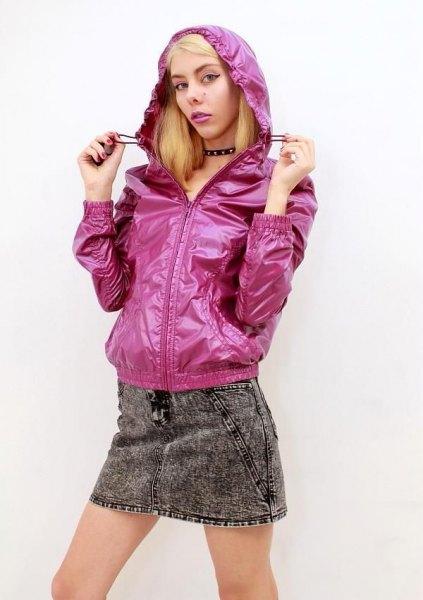 neon pink hooded nylon jacket with gray mini denim skirt