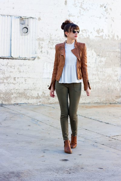 tank leather jacket with white peplum top and gray jeans