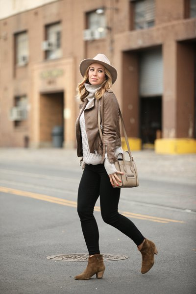 leather jacket with gray sweater neck shirt and white felt hat