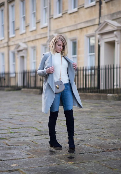 white sweater with gray long jacket and blue high jeans