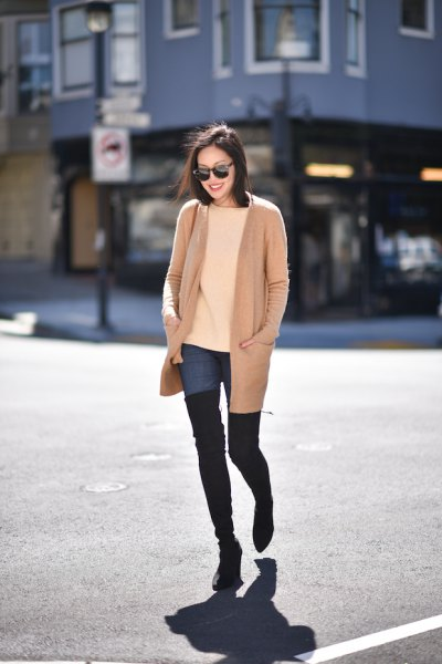 pink pink long jacket with blue high jeans and black thigh high boots