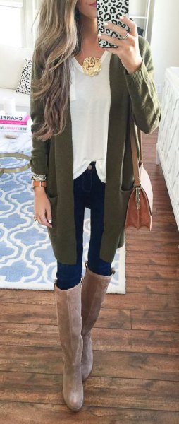 green cardigan with white top and gray knee high boots