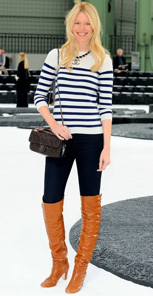 black and white striped knit sweater with long jeans and orange boots