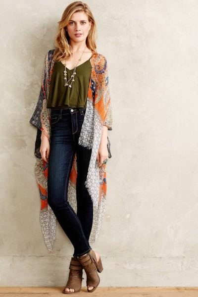 green cropped spaghetti strap top with silk robe and dark jeans