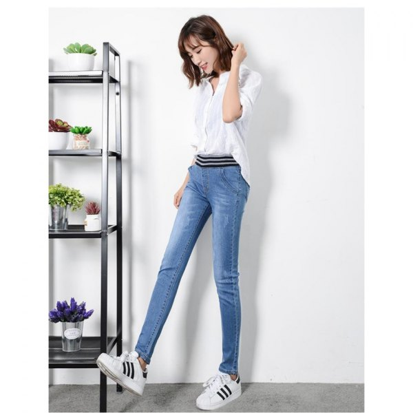 white half-warm blouse with blue high waist jeans