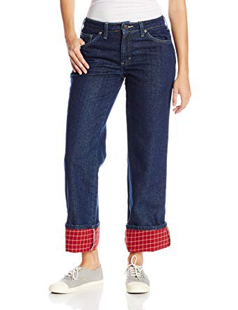 white form fitting top with blue and red flannel lined cuffed jeans