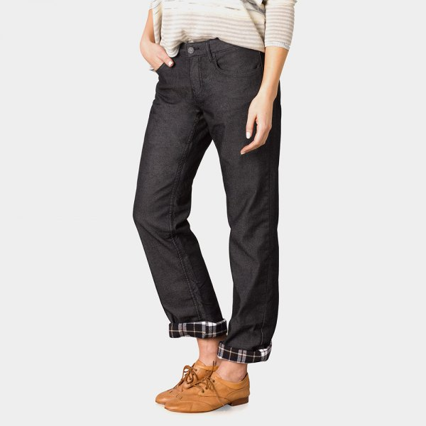 light gray and white sweater with black, straight legs cuffed flannel cap jeans