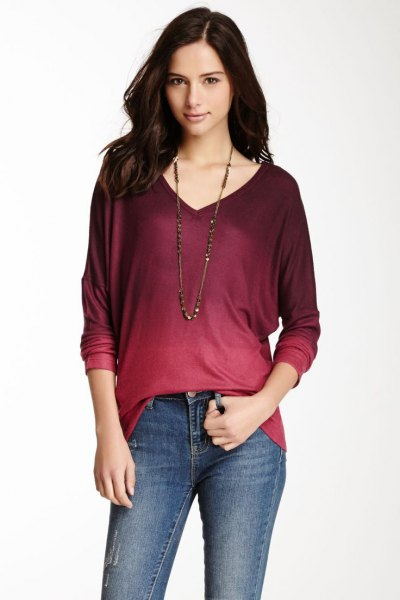 red and black tie color long sleeve v-neck t-shirt with skinny jeans
