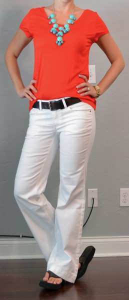 red tee with white puffed jeans