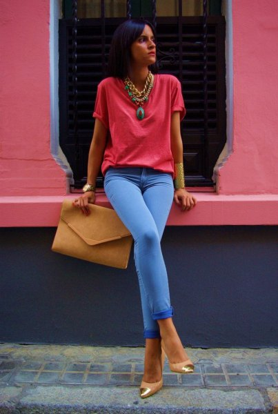 red t-shirt with sky blue jeans and statement necklace