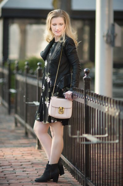 leather jacket with black floral mini dress and heeled boots