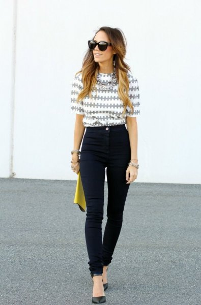 gray and white printed half-heated blouse with black high waist jeans
