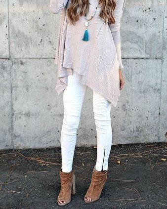 light gray knitted tunic top with white jeans with zipper