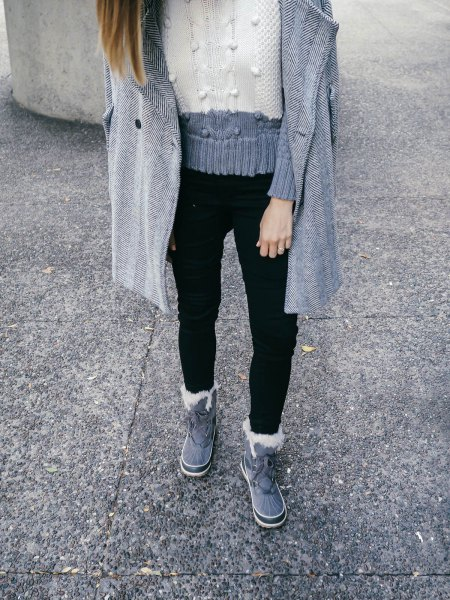 gray and white color blocks knitted sweater with black jeans