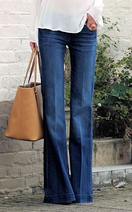 white chiffon blouse with puffed jeans and brown leather bag
