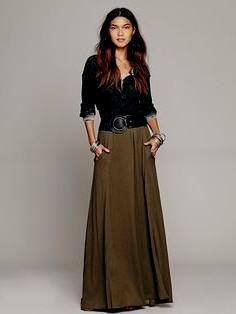 black scoop neck blouse with belt maxi green skirt