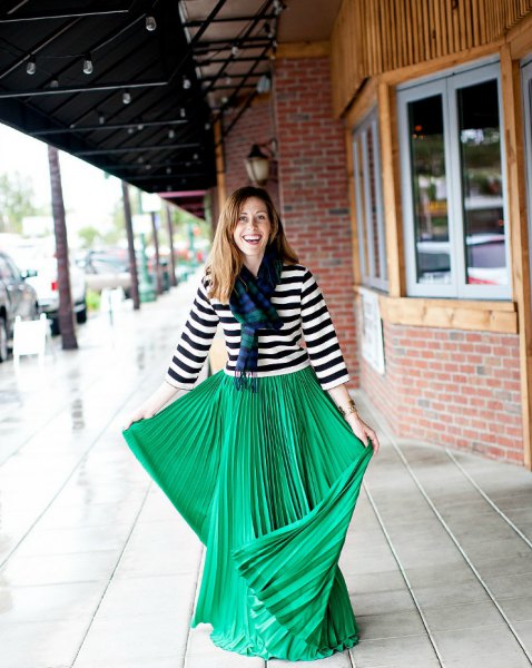 black and white striped three-sleeve tee with green pleated maxi skirt