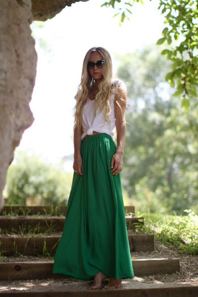 white knotted sleeveless t-shirt with green flared maxi skirt