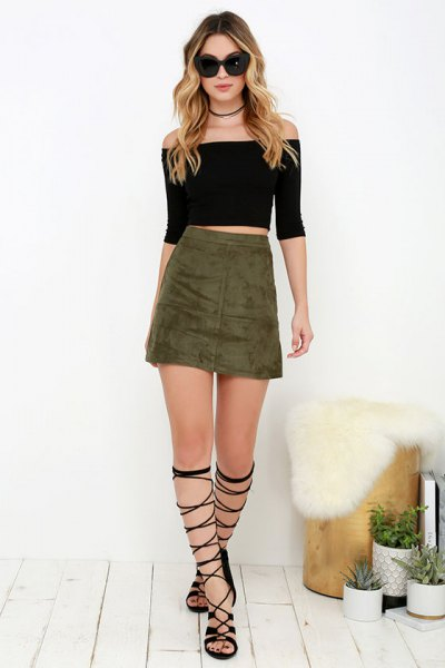 black of the shoulder crop with olive green skirt and gladiator shoes