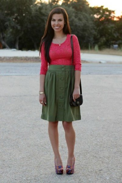 orange molded half sleeve lace top with green knee length skirt