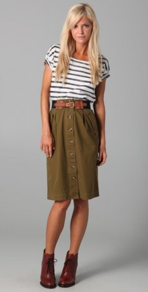 black and white striped t-shirt with high waisted olive knee length skirt