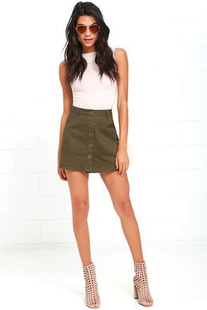 white sleeveless fitted top with olive green button cover at the front