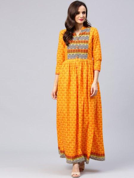 mustard three quarter sleeve tribal printed maxi dress