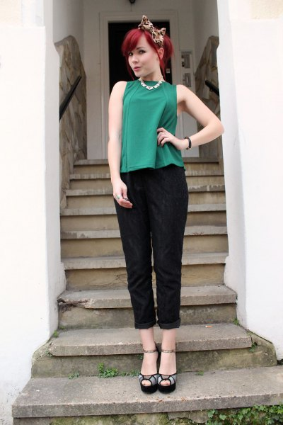 green sleeveless top with black cuff pants