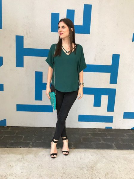 green short-sleeved chiffon blouse with black chinos