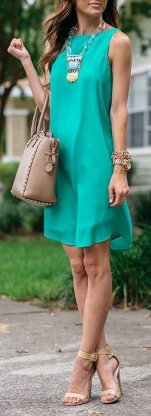 teal blue sleeveless mini chiffon plant dress with boho necklace