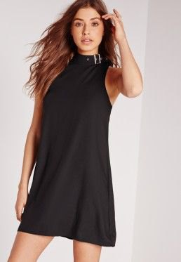 black shift dress in black neck with matching heels with open toe