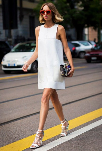 white sleeveless dress with matching open toe flaps
