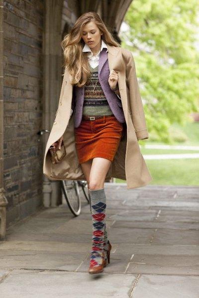 blush pink long jacket over gray short blazer and brown mini skirt