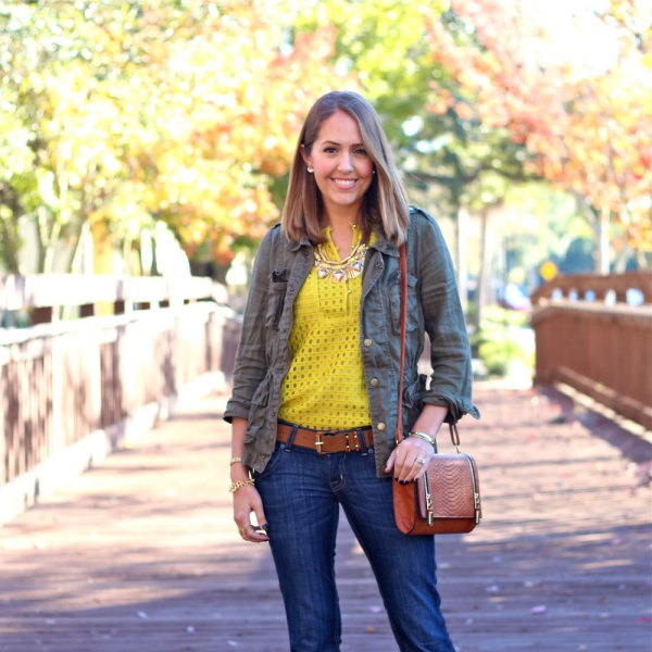 yellow cutout shirt with gray comrade shirt and dark jeans