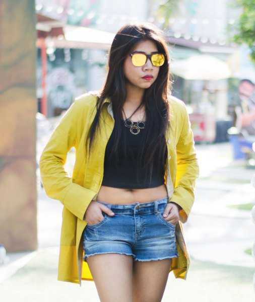 mustard shirt with black crop top and denim shorts