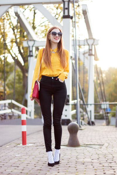 yellow button up shirt with black high skinny jeans
