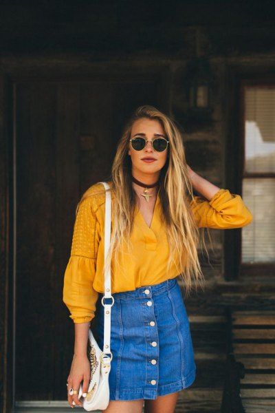 mustard v-neck blouse with blue denim high waist mini skirt