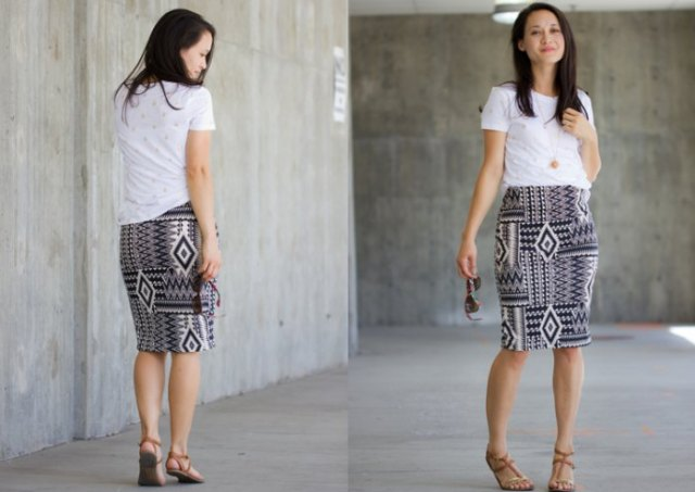 white tee with black and white stem printed knee length knit skirt